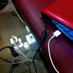 Two adapters in one outlet charging three devices