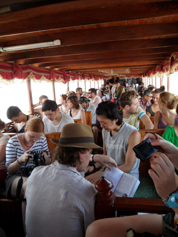 Backpackers crowded on a boat