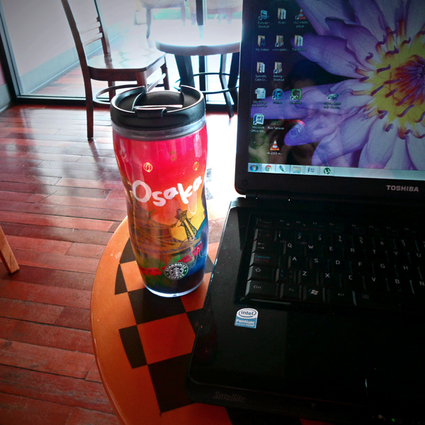 Osaka Starbucks Coffee Mug next to laptop in Chiang Mai