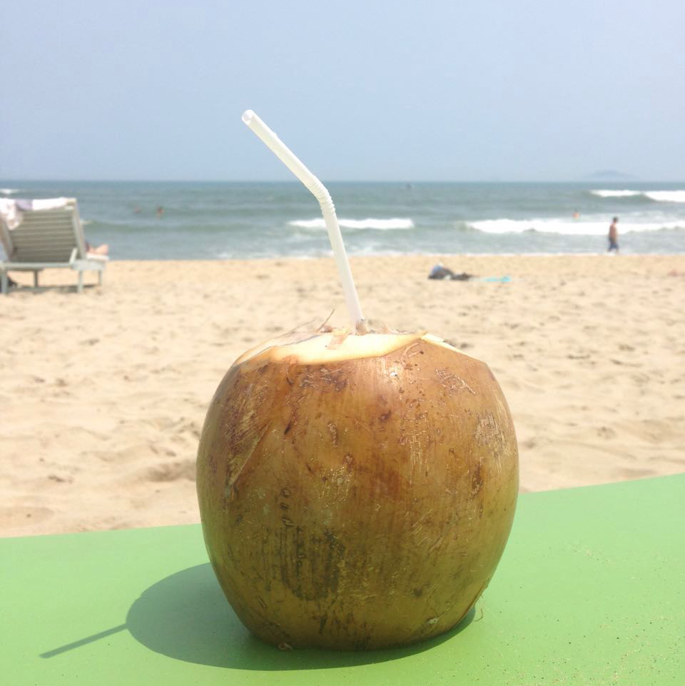 Enjoying a coconut at An Bang beach.
