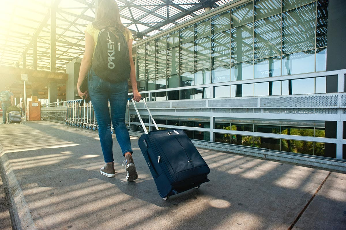 Woman with suitcase at airport